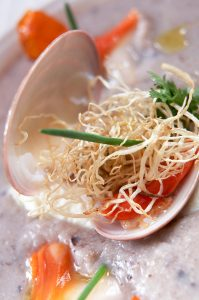Nefeli restaurant seafood dish in a shell at Yria Island luxury Boutique Hotel & Spa in Paros