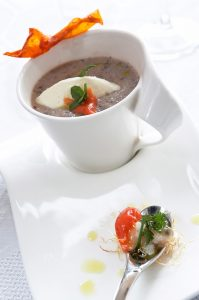 Nouvelle cuisine style dish with foam presented in a cup at Yria luxury Hotel restaurant in Paros