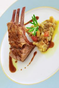 Lamb ribs & vegetables dish presented in nouvelle cuisine style at Yria Hotel restaurant in Paros