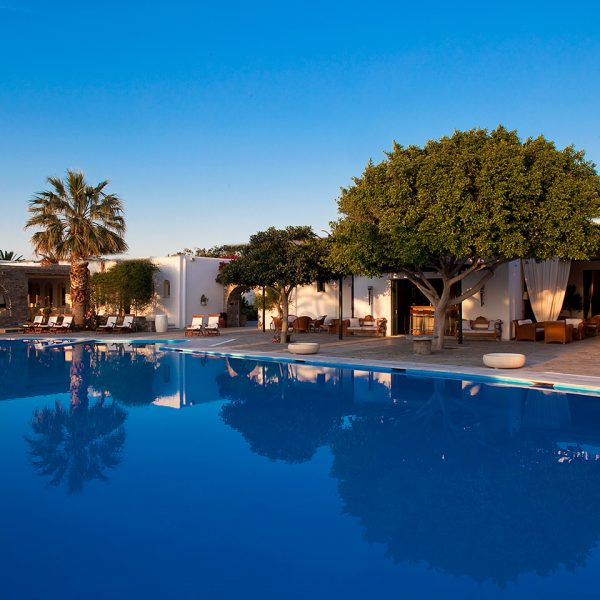 Sunbeds & trees around the pool at Yria Island Luxury Boutique Hotel resort & Spa in Paros