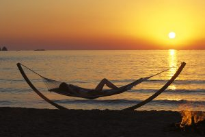 Hammock on Parasporos beach at sunset near Yria Hotel, which offers guests an early booking offer