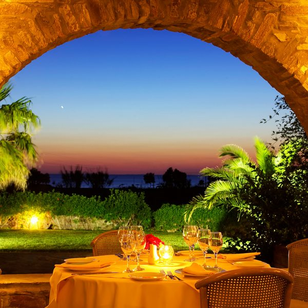 Sunset sea view dining at Yria Island Boutique Hotel Nefeli restaurant in Parasporos bay, Paros