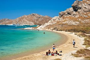 Tourists enjoy one of many beautiful beaches on Paros island, Greece, which is home to Yria Hotel