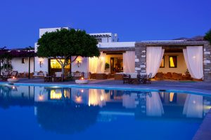 An early evening view of the Yria Boutique Hotel resort spa complex & swimming pool in Paros