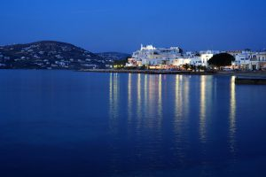 Nighttime view of the twinkling lights of Parikia, the capital of the island of Paros, Greece