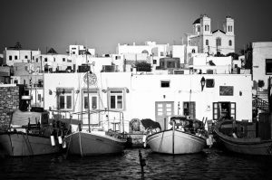 Black & white photo of small boats moored in a harbour in Paros, Greece, the home of Yria Hotel