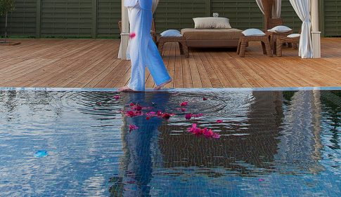 Walking barefoot by the plunge pool during one of the Yria Hotel spa package holidays in Paros