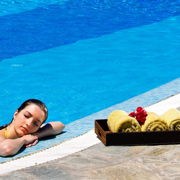 Woman enjoys the private pool at the Yria Island luxury Hotel & Spa Pool Experience Suite in Paros