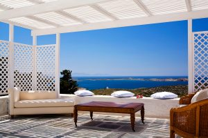Shaded sea view private terrace with furniture at the Yria Island Hotel luxury villa rental in Paros
