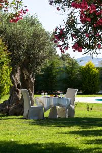 Al fresco dining in the gardens by the Yria Boutique Hotel Villa private pool near Parikia, Paros