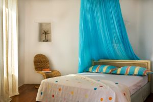 Bed in one of the 4 master bedrooms in Yria Island Boutique Hotel luxury private pool villa in Paros