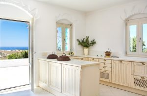 Yria Hotel private pool villa rustic kitchen by sea view veranda overlooking Parasporos bay, Paros