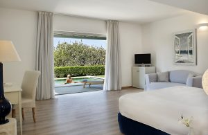 Pool Experience Suite bedroom with veranda doors to private pool at the Yria luxury Hotel in Paros