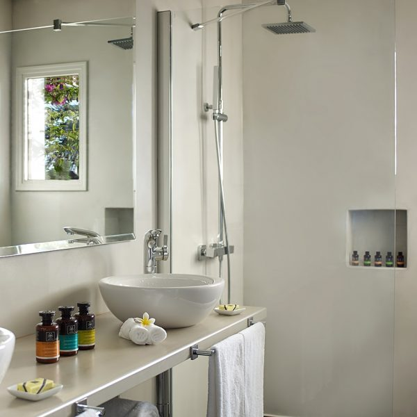 Luxury bathroom in Yria Hotel Executive Suite in Paros, with shower, mirror & washbasins