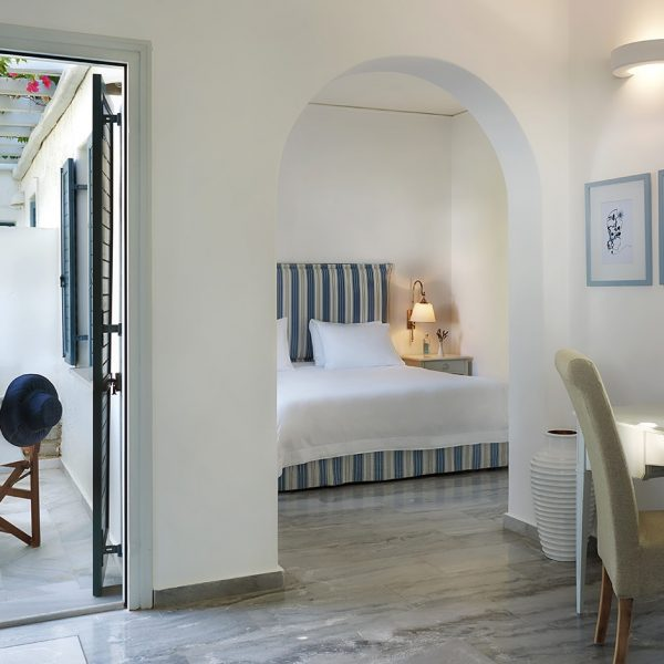The interior of the Yria Island Boutique Hotel & Spa Junior Suite in Paros with private veranda