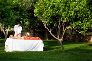 A lady has a spa massage in the gardens at Yria Island Boutique Hotel & Spa Resort in Paros