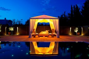 Relaxing on a sofa at dusk inside the pavilion at the Yria Island luxury Boutique Hotel Spa in Paros