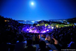 Crowds in an amphitheatre in Paros, Greece, watch a classical concert performance
