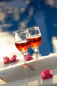 Glasses of rosé by the pool at Seleni sea view bar at Yria Island Boutique Hotel & Spa in Paros