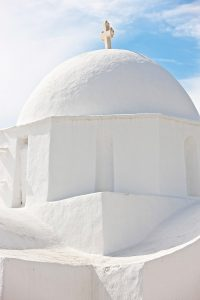 Crisp lines of the dome tower of an archetypal Cycladic design church in Paros, Greece
