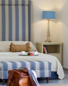 King size bed in luxury Junior Suite accommodation in Paros at Yria Island Boutique Hotel & Spa