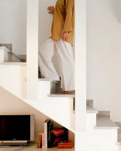 Walking up the stairs of the 2 floor Maisonette accommodation at Yria Island Boutique Hotel in Paros