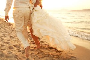 Bride & groom on the beach at Parasporos after their Greek island wedding at Yria Hotel in Paros