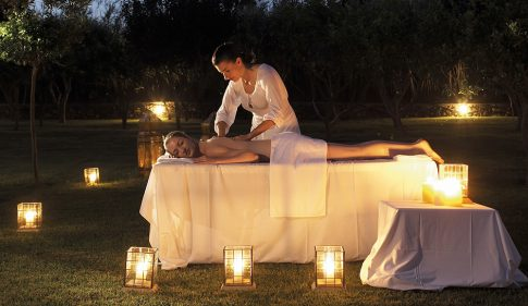Woman enjoys a relaxing spa massage package on a spa holiday in Paros at Yria Island Boutique Hotel