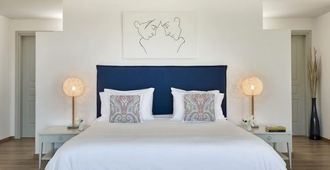 Bed & pillows in stylish luxury accommodation at Yria Island Boutique Hotel & Spa in Paros