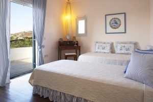 Beds facing balcony veranda with Paros mountain view at Yria Hotel luxury family Residence Suite