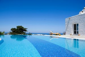 Private infinity pool with sea view outside Yria Ktima luxury villa rental at Yria Hotel in Paros