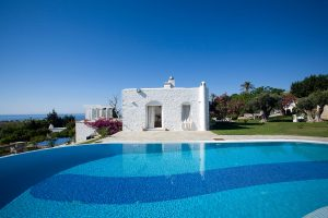 Exterior of Yria luxury villa in Paros, surrounded by private pool & gardens & overlooking the sea