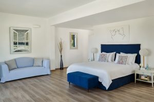 Private Pool Experience Suite bedroom with king size bed & sofa at Yria Resort Hotel & Spa in Paros