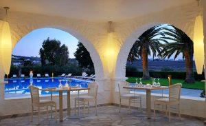 Tables overlooking the pool at the Nefeli restaurant at Yria Island Boutique Hotel & Spa in Paros