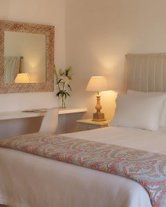 King size bed in the Yria Island Boutique Hotel & Spa Executive Suite couples accommodation in Paros