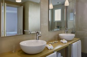 Twin sinks & mirrors in bathroom of Executive luxury couples suite at Yria Boutique Hotel in Paros