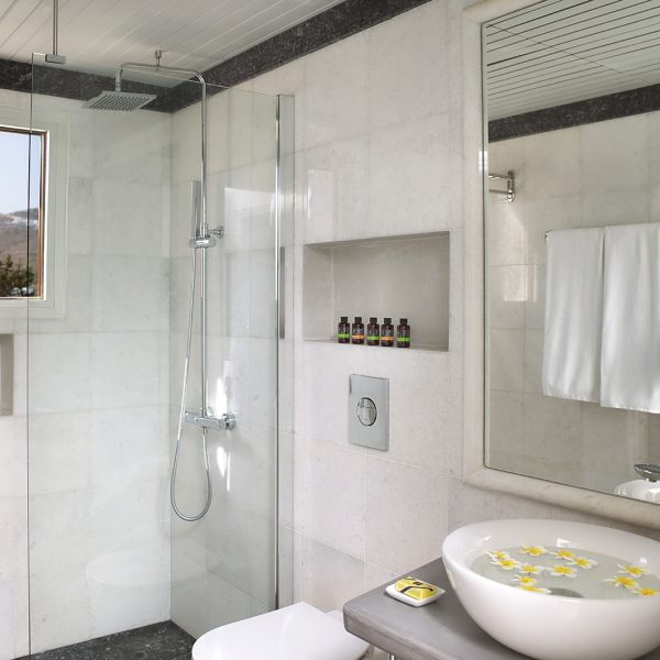 Junior Suites at Yria Island Boutique Hotel & Spa in Paros have a modern luxury bathroom with shower