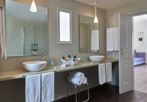Luxury bathroom in Yria Hotel Pool Experience Suite in Paros, with twin basins, towels & toiletries
